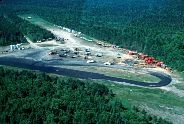 TBM fleet of 13 at Boston Brook airstrip - pits and aircraft parking area, June 1977.