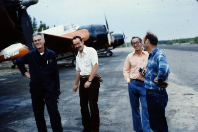 Pilots John Lapham, Larry Creasey, Cecil Peck and Mort Gosset at Juniper Airstrip, NB, 1976. Photo by Don McKnight.