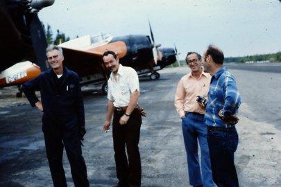 Pilots John Lapham, Larry Creasey, Cecil Peck and Mort Gosset at Juniper Airstrip, NB, 1976. Photo by Don McKnight.