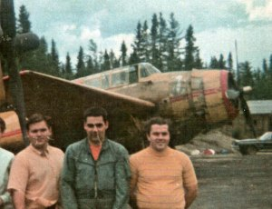 Pink Rabbit Team, Juniper, NB, 1970. L to R: Claude Marcoux (Lead TBM pilot), John Lavigne (#3 TBM pilot), Berry Paton (#2 TBM pilot) in front of Maritime AS TBM#911 FXON, with MAS #900 FXOM in back.