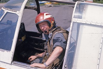 Merrill McBride in cockpit of Miramichi Air Service #23, FZTS, 1972.