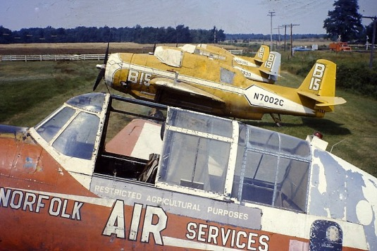 Lineup at airstrip, Norfolk Air Services, Simcoe, Ont., 1973. TBM #5 FAYG, Former Air Tanker TBMs B15 N7002C, B19 N17930 and B16 N9596C [Paul Schaareman]