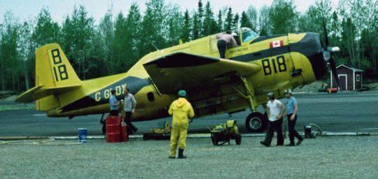 Norfolk #B18 GLDX, with the yellow and black paint job that Norfolk used in its later years, in the pits at Juniper, 1981. [E. Kettela, Canadian Forest Service]